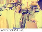 Купить «Asistant demonstration fashion yellow pullover to woman in boutique», фото № 29943102, снято 15 марта 2018 г. (c) Яков Филимонов / Фотобанк Лори