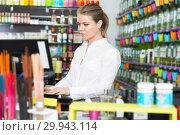 Купить «saleswoman working behind counter», фото № 29943114, снято 24 апреля 2018 г. (c) Яков Филимонов / Фотобанк Лори