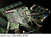 Купить «St.Petersburg, Russia - April 2018 -Printed circuit board. Computer technology background.», фото № 29943418, снято 13 апреля 2018 г. (c) Мельников Дмитрий / Фотобанк Лори