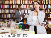Купить «Thoughtful girl in bookshop», фото № 29951570, снято 18 января 2018 г. (c) Яков Филимонов / Фотобанк Лори