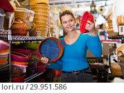 Купить «Nice female teen choosing colour wicker basket», фото № 29951586, снято 13 декабря 2017 г. (c) Яков Филимонов / Фотобанк Лори