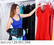 Купить «Woman shopping in clothing boutique», фото № 29951594, снято 17 сентября 2018 г. (c) Яков Филимонов / Фотобанк Лори