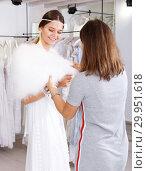 Купить «Consultant helping woman with fitting of white gown», фото № 29951618, снято 17 сентября 2018 г. (c) Яков Филимонов / Фотобанк Лори