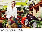 Купить «Woman looking for vegetables in farmers market», фото № 29951766, снято 13 февраля 2018 г. (c) Яков Филимонов / Фотобанк Лори
