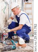 Купить «Electrician mounting electrical wiring», фото № 29951782, снято 28 мая 2018 г. (c) Яков Филимонов / Фотобанк Лори