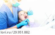 Купить «Girl getting dental treatment», фото № 29951882, снято 1 марта 2018 г. (c) Яков Филимонов / Фотобанк Лори