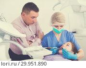 Купить «Worried father with daughter during dental treatment», фото № 29951890, снято 1 марта 2018 г. (c) Яков Филимонов / Фотобанк Лори