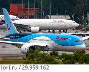 Купить «Dreamliner Thomson on the runway», фото № 29959162, снято 29 ноября 2016 г. (c) Игорь Жоров / Фотобанк Лори