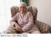 Купить «Front view of senior woman looking at camera in home», фото № 29960502, снято 22 ноября 2018 г. (c) Wavebreak Media / Фотобанк Лори