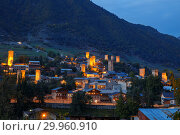 Купить «Mestia at dusk, illuminated Svan towers on the background of a mountain slope, Upper Svaneti, Georgia», фото № 29960910, снято 28 сентября 2018 г. (c) Юлия Бабкина / Фотобанк Лори