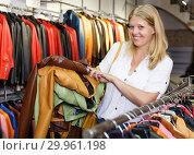 Купить «Woman choosing leather jacket», фото № 29961198, снято 5 сентября 2018 г. (c) Яков Филимонов / Фотобанк Лори