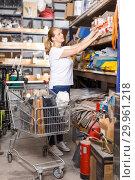 Купить «Woman with basket looking construction materials at shelves in build store», фото № 29961218, снято 20 сентября 2018 г. (c) Яков Филимонов / Фотобанк Лори