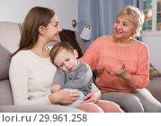 Купить «Two adult female are talking about upbringing kid», фото № 29961258, снято 15 февраля 2018 г. (c) Яков Филимонов / Фотобанк Лори