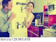 Купить «Loving couple looking out from behind counter of mixers», фото № 29961618, снято 15 июня 2017 г. (c) Яков Филимонов / Фотобанк Лори