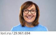 Купить «portrait of happy senior woman in glasses», видеоролик № 29961694, снято 11 февраля 2019 г. (c) Syda Productions / Фотобанк Лори