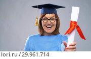 Купить «happy senior graduate student woman with diploma», видеоролик № 29961714, снято 11 февраля 2019 г. (c) Syda Productions / Фотобанк Лори