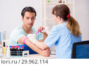 Купить «Young patient during blood test sampling procedure», фото № 29962114, снято 24 июля 2018 г. (c) Elnur / Фотобанк Лори