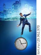 Купить «Businessman in deadline and time management concept», фото № 29962970, снято 19 марта 2019 г. (c) Elnur / Фотобанк Лори