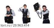 Купить «Young businessman with cuffs isolated on white», фото № 29963414, снято 16 марта 2015 г. (c) Elnur / Фотобанк Лори