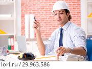Купить «Construction supervisor working on blueprints», фото № 29963586, снято 13 сентября 2018 г. (c) Elnur / Фотобанк Лори