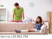 Купить «Husband helping leg injured wife in housework», фото № 29963794, снято 4 октября 2018 г. (c) Elnur / Фотобанк Лори