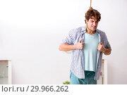 Купить «Young man preparing to commit suicide by hanging», фото № 29966262, снято 25 сентября 2018 г. (c) Elnur / Фотобанк Лори
