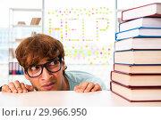 Купить «Student preparing for university exams», фото № 29966950, снято 4 сентября 2018 г. (c) Elnur / Фотобанк Лори