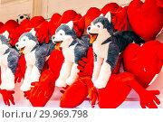 Купить «Russia, Samara, January 2019: plush dogs are sold with plush hearts for Valentine's Day in a large supermarket.», фото № 29969798, снято 16 января 2019 г. (c) Акиньшин Владимир / Фотобанк Лори