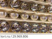 Купить «New shiny stainless steel pots on store shelves.», фото № 29969806, снято 16 января 2019 г. (c) Акиньшин Владимир / Фотобанк Лори