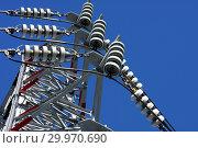 Купить «Опора ЛЭП с высоковольтными проводами на фоне голубого неба», фото № 29970690, снято 30 января 2010 г. (c) Александр Гаценко / Фотобанк Лори