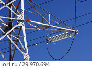 Купить «Опора ЛЭП с высоковольтными проводами на фоне голубого неба», фото № 29970694, снято 30 января 2010 г. (c) Александр Гаценко / Фотобанк Лори