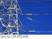 Купить «Опора ЛЭП с высоковольтными проводами на фоне голубого неба», фото № 29970698, снято 30 января 2010 г. (c) Александр Гаценко / Фотобанк Лори