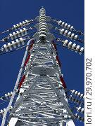 Купить «Опора ЛЭП с высоковольтными проводами на фоне голубого неба», фото № 29970702, снято 30 января 2010 г. (c) Александр Гаценко / Фотобанк Лори