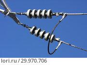 Купить «Опора ЛЭП с высоковольтными проводами на фоне голубого неба», фото № 29970706, снято 30 января 2010 г. (c) Александр Гаценко / Фотобанк Лори