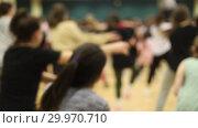 Купить «Open dance lesson. A group of people dancing. A girl with dark hair is actively dancing.», видеоролик № 29970710, снято 16 февраля 2019 г. (c) Константин Шишкин / Фотобанк Лори