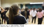 Купить «Open group dance lesson. The girl listens to the teacher.», видеоролик № 29970734, снято 16 февраля 2019 г. (c) Константин Шишкин / Фотобанк Лори