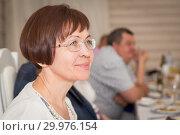 Купить «Cute elegant middle-aged woman posing smiling at a holiday.», фото № 29976154, снято 18 мая 2018 г. (c) Акиньшин Владимир / Фотобанк Лори