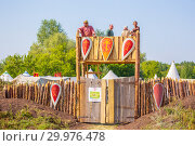 """Купить «Russia, Samara, August, 2018: Medieval marching camp with a moat, rampart and fortress gates. Military history festival """"Military case"""" with», фото № 29976478, снято 5 августа 2018 г. (c) Акиньшин Владимир / Фотобанк Лори"""