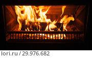 Купить «Firewood burns in fireplace, close-up», фото № 29976682, снято 26 января 2019 г. (c) EugeneSergeev / Фотобанк Лори