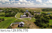 Купить «Summer rural landscape with orthodox temple in Russia», видеоролик № 29976770, снято 15 февраля 2019 г. (c) Володина Ольга / Фотобанк Лори
