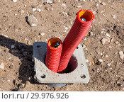 Купить «Монтаж кабельного ввода при строительных работах», фото № 29976926, снято 22 августа 2018 г. (c) Вячеслав Палес / Фотобанк Лори