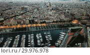 Купить «View from drones of sailboats and yachts in old port of Barcelona and gothic quarter at night», видеоролик № 29976978, снято 28 сентября 2018 г. (c) Яков Филимонов / Фотобанк Лори