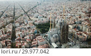 Купить «Aerial view of Barcelona and famous Sagrada Familia church, Catalonia, Spain», видеоролик № 29977042, снято 19 ноября 2018 г. (c) Яков Филимонов / Фотобанк Лори
