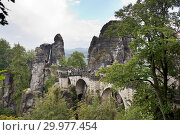 Bastei rocks and Bastei Bridge in Saxon Switzerland National Park, Germany (2014 год). Стоковое фото, фотограф Куликов Константин / Фотобанк Лори