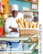 Proud owner of bakery shop wearing white uniform. Стоковое фото, фотограф Яков Филимонов / Фотобанк Лори