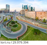 Купить «Aerial top view of road junction in Moscow from above, automobile traffic and jam of many cars, transportation concept», фото № 29979394, снято 20 ноября 2019 г. (c) Mikhail Starodubov / Фотобанк Лори