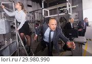 Купить «Anxious businessman running», фото № 29980990, снято 29 января 2019 г. (c) Яков Филимонов / Фотобанк Лори