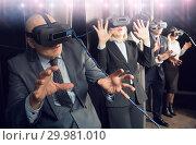 Купить «Excited man in virtual reality room», фото № 29981010, снято 29 января 2019 г. (c) Яков Филимонов / Фотобанк Лори