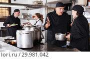 Купить «Chef male dissatisfied with the work of girl helper», фото № 29981042, снято 5 декабря 2018 г. (c) Яков Филимонов / Фотобанк Лори