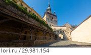 Купить «View of clock tower from fortress square in Sighisoara», фото № 29981154, снято 16 сентября 2017 г. (c) Яков Филимонов / Фотобанк Лори